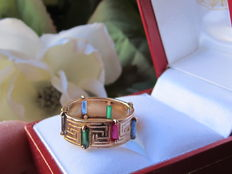 18 kt gold ring set with 2 rubies, 2 emeralds, 2 amethysts, 2 sapphires.