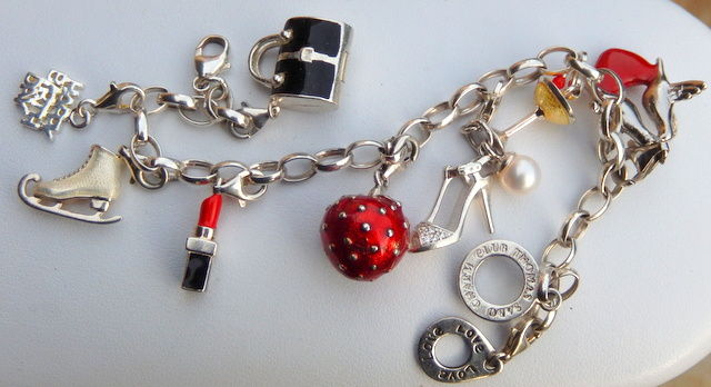 "Bracelet with 9 charms, all in silver, marked ""Thomas Sabo"""