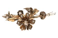 Yellow gold brooch set with 11 rose cut diamonds of approx. 0.42 ct in total.