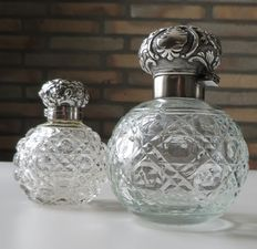 Antique perfume bottles with silver caps of which 1 is from England from 1902