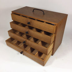 Vintage instruments cabinet with four drawers and interior compartments, mid 20th century