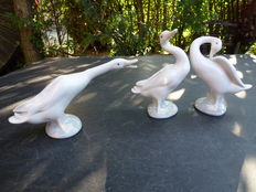 Lladro - three sculptures of geese.