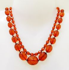 2 x Art Deco necklace made of facetted amber in honey, caramel colours, 66.1g.