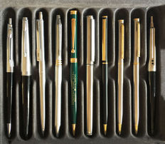 A lot of 10 different pens:  8 ballpoint pens, 1 rollerball pen and 1 fountain pen.