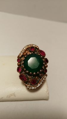 Ring in 800/1000 silver and 14 kt gold, with emerald, rubies and diamonds.