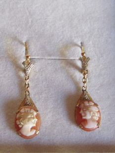 "Gold cameo ""sleeper"" earrings."