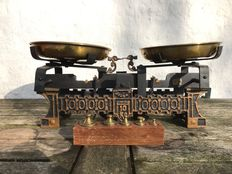 Cast iron scales with wood marble and brass scales including marks and matching weights block - ca.  1900