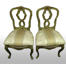 A pair of Venetian green lacquered, parcel gilt and polychrome painted side chairs - Italy - second half of the 19th century