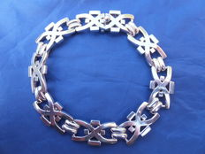 """Heavy silver hand-forged bracelet of a large size. Signed """"Revern"""".  Europe, 20th century"""