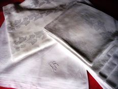 Two very beautiful damask tablecloths, one is a set including 6 napkins, ca 1920