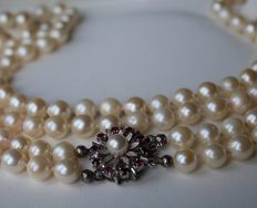 2-row long and heavy pearl necklace with 135 Japanese Akoya salt water pearls Ø 7,5-7,9 mm and a beautiful  White gold buckle with high quality 10 natural Rubies approx. 1 Ct.