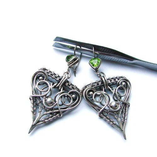 Silver earrings are made by hand with olivine 0.6ct, silver halmarked 925
