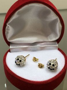 Gold smiley ear studs with brilliant cut white and black zirconia