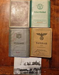 WW2 some (4) passes with a Wehrpas of an oberleutnant, a Kriegsmarinepass,  a military police pass and a work pass.