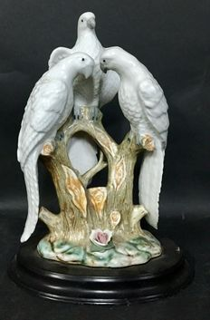 Elegant hand-painted porcelain figures of cockatoos