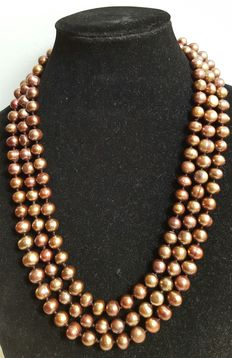 Very long necklace with large cultured freshwater bronze coloured pearls