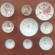 Lot of nine beautifully decorated Japanese Imperial Army sake Memorial cups