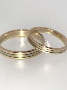 Set of gold tricolour engagement rings.