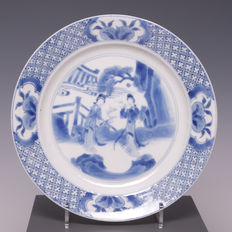 Blue and white porcelain plate – beautiful decoration of Chinese ladies in a garden – China – early 18th century (Kangxi period).