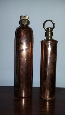 2 red copper hot water bottles with yellow-copper/brass caps