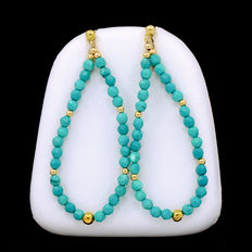 Long dangle 18 kt yellow gold earrings composed of turquoise beads
