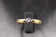 14KT bi-coloured gold ring with solitary diamond 0.030 ct.
