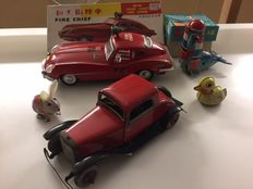 STF, China/Chad Valley, England - Length 7-27 cm - Lot Tin toys with Fire Chief car, Vintage Coupe, rabbit, sea lion and duckling with clockwork/friction/battery engine, 1950s/80s