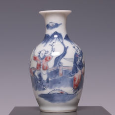 Beautiful under-glaze porcelain vase decorated in red and blue, young boys playing in a garden – China – 19th century
