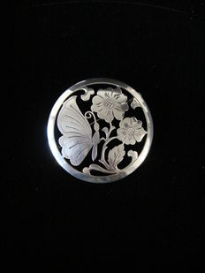 Large sawn silver brooch with a hammered motif of a butterfly with flowers