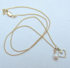 Yellow gold fox tail necklace with two gold pendants