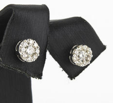 White gold stud earrings with 18 brilliant-cut diamonds in pressure setting.