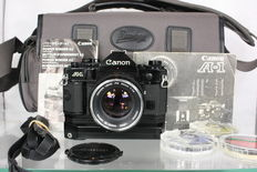 Canon A-1 with  Canon FD 50mm f1.4 objective, Canon Power winder A2, 3 colour filters and flamingo shoulder bag