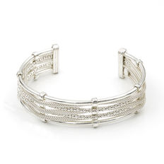 Sterling silver open cuff with silver cord design