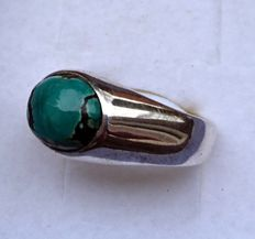 Silver and turquoise signet ring.