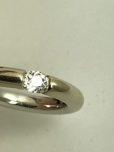 18k Solitaire diamond tension setting ring  --  size 54