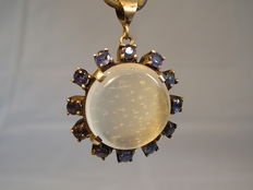 Large moonstone pendant with sapphire entourage approx. 1.80ct.