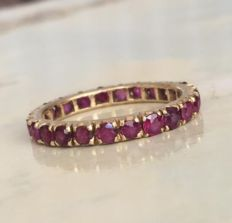 Yellow gold women's full eternity ring with in total approx. 1.68 ct of rubies