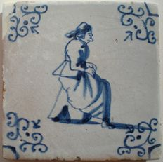 Antique tile with a woman sitting on a poop chair (rare depiction)
