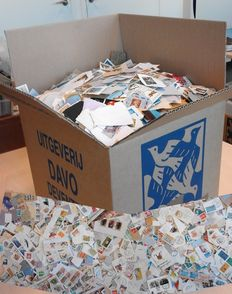 World – box with 10kg of world stamps on paper