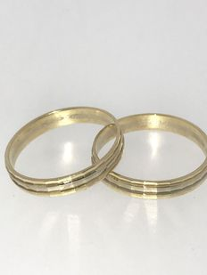 Set of gold bi-colour engagement rings