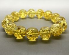 Bracelet  with natural Baltic amber beads 12.7 mm in diameter