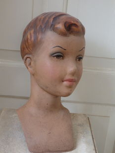 Life-size bust, window display of a boy