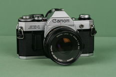 Canon AE-1 35mm SLR camera & Canon FD 50mm 1:1.8 S.C. lens. Made in Japan.