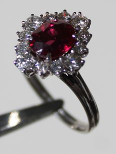 Ring with 12 diamonds totalling 0.60 ct and a ruby, 2.29 ct.