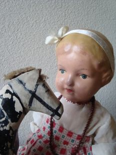 "Old ""Wildebras"" doll with antique wooden horse"
