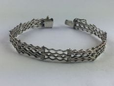 A massive bracelet with open-worked links made of genuine 925 silver from Mexico around 1970