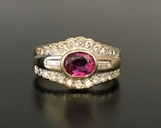 Yellow gold 18kt ring with a central ruby and paved with baguette cut and brilliant cut H-VVS diamonds.
