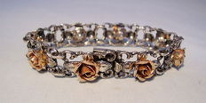 Silver bracelet with rose gold roses