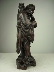 Wooden statue of an immortal with silver inlay - China - Mid 20th century