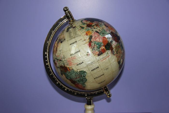 World globe made from mother of pearl and 45 various precious world globe made from mother of pearl and 45 various precious stones inlaid with 14ct yellow gold 420 mm gumiabroncs Image collections